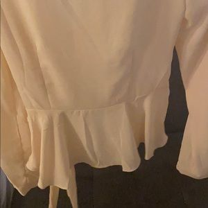 Forever 21 Tops - NWT cream color blouse. Side zipper.